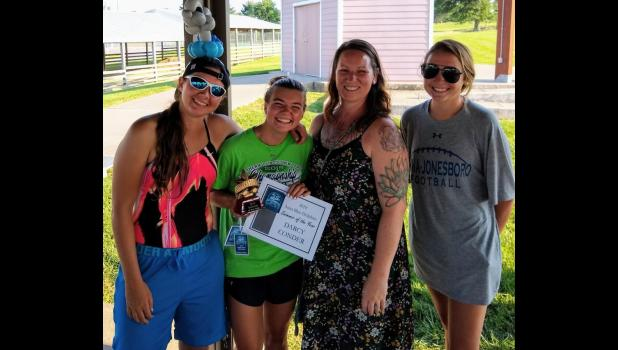 Darcy Conder was named swimmer of the year. She is with coaches Maci, Melissa and Clair. Photo provided.