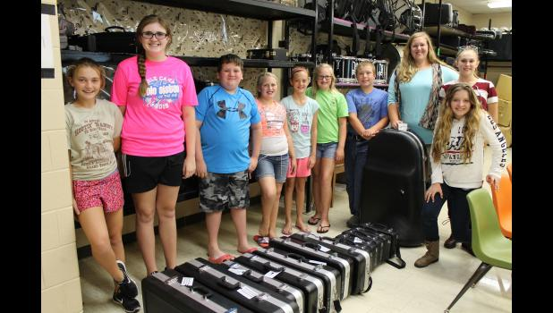 From left are Megan Theis, Alyssa Flores, Westin George, Kinley Lingle, Hailey Wright, Peyton Lingle, Noah Wiseman, Rebecca Gray, Michelle Wolford and Madison Boner with their new instruments. Photo by Lindsey Rae Vaughn.