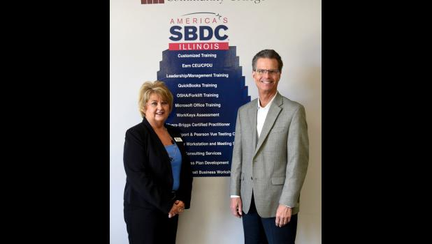 Victor Narusis, the director of business development for the Illinois Department of Commerce and Economic Opportunity was greeted by Candy Eastwood, coordinator for the Center of Community and Economic Development and Illinois SBDC at SCC, during his visit on May 9. SCC photo.