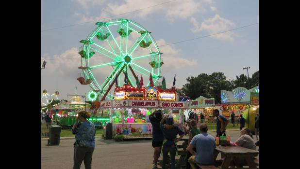 The image shows the ferris wheel at the Union County Fair in Anna lit up just after totality. Photo by Amber Filbeck.