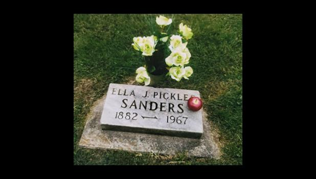 """With green roses and an """"apple for the teacher."""" Mrs. Ella Jane Pickles Sanders' monument at the Jonesboro Cemetery. Submitted by Barbara Bauer for Emily Boyd Meyer."""
