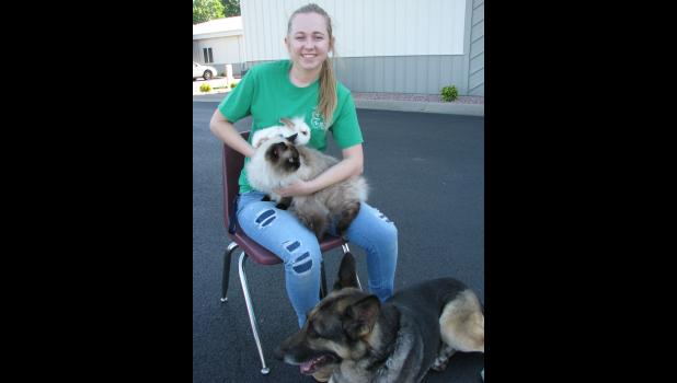 Erin Dillow of Anna showed her rabbit Lazarus, her Himalayan cat Merlin and her German shepherd dog Sasha. Erin is a member of the Lick Creek 4-H Club and the daughter of Rhonda and Greg Dillow.