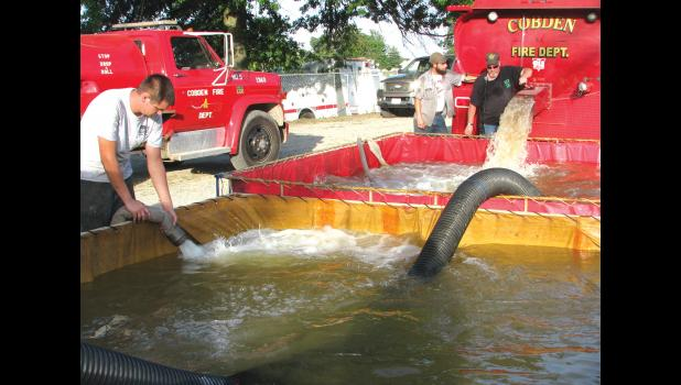 Water was pumped out of the pond at the park into portable tanks which were being used for the training.