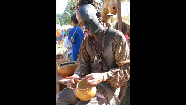 "Perry Riley Jr. of Kingman, Ind., was creating works of art with gourds and other materials. On his business card, Riley describes himself as a ""Living Historian and maker of fine gourds, drawings, paintings and other fine wares."""