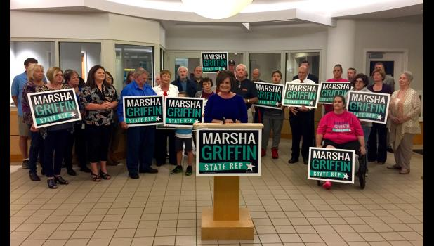 Marsha Griffin of Jonesboro, standing at podium, announced her candidacy for state representative Thursday evening, Oct. 19, in Carbondale. Photo provided.