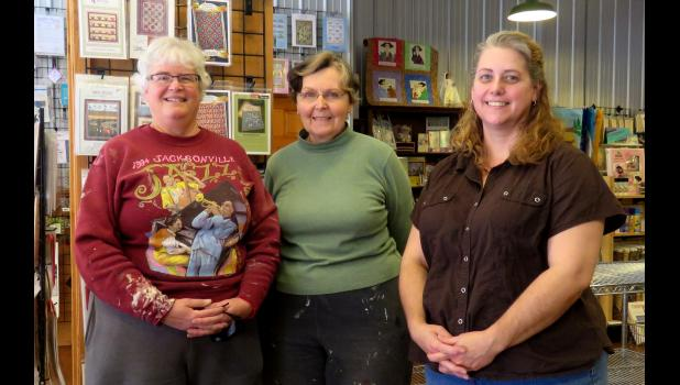 Lee Hackney and Susan Whitemountain are transforming three buildings on Main Street in Anna into new businesses. From left are Hackney, Whitemountain and The Here and Now Shop manager Ilse Easterly. The Here and Now Shop sells supplies for DIY projects. Photo by Amber Skelton.