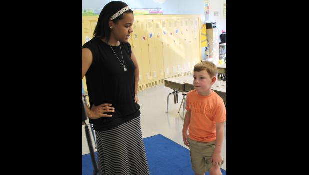 First grade teacher Briana Hammon talked to her student, Braysen Dillow, about his summer.