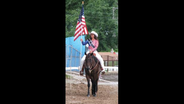 The 2015 Union County Fair Queen, Kaitlin McWhorter, carried an American flag during the horse show at the grandstand Saturday, Aug. 20.