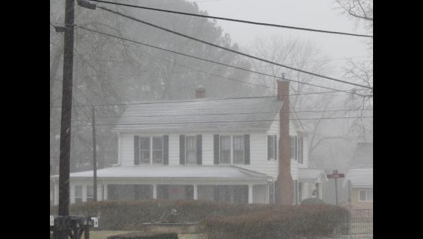 This was the view from the front porch of the photographer's abode just as the snow started to fall last Saturday afternoon...the house is less than a block away...