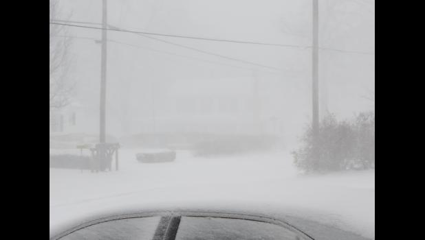 ...less than an hour later, this was pretty much the same view from our front porch. The National Weather Service had warned about the possibility of white-out conditions.