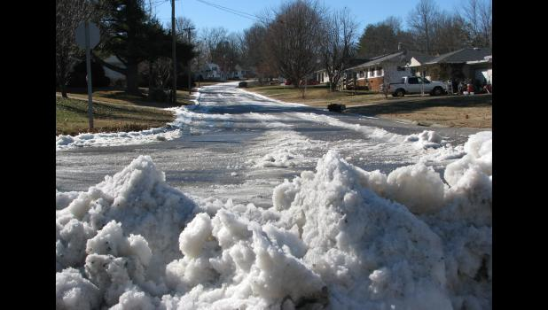 Lots of ice could be seen on Plum Street in Anna Tuesday. The conditions were created after a leak developed on nearby Apple Lane. In the midst of bitter cold weather early this week, a number of frozen water meters were reported along Main Street in Anna.