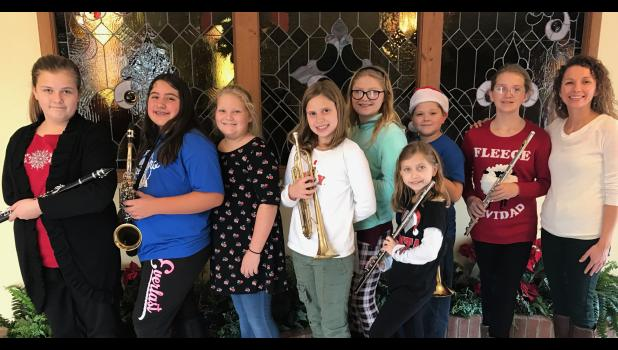 From left are Jaden Ebberts, 6th grade, clarinet; Isabel Tehandon, 6th grade, alto saxophone; Lacey Crow, 6th grade, voice; Cadence Black, 5th grade, trumpet; Alyson Hasty, 5th grade, clarinet; Ella Lingle, 5th grade, flute; Jason McAlister, 5th grade, trombone; Sydney Waun, 6th grade, flute; and Stephanie Bushno, music teacher. Photo provided.