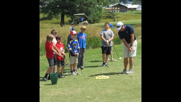 Instructor Matt Lang helped young golfers to fine tune their chipping skills.