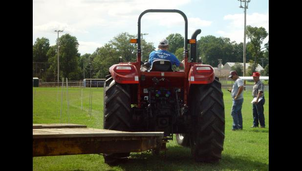 Kids and teenagers competed in the Junior Tractor Operators contest at the Union County Fair Monday afternoon. Participants demonstrated their skills by driving a tractor and trailer through a course. Judges observed and assigned points for each attempt. Photo by Amber Skelton.