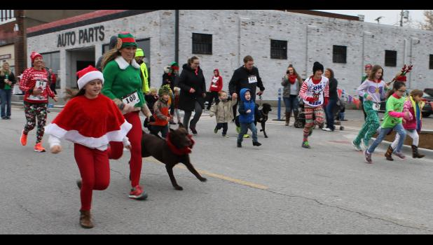 Kids, adults and dogs participated in the Fun Run with Rudolph and Santa after the Reindeer Run.