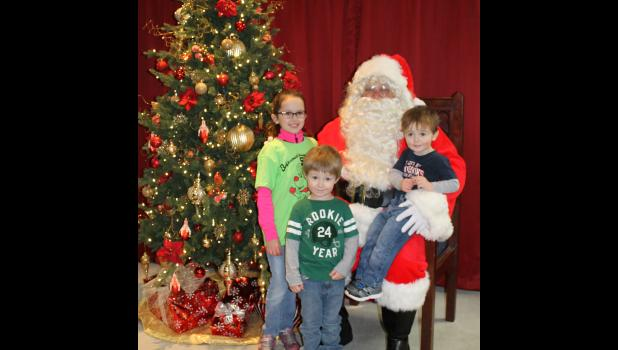Rachel Kaufman, Jet Newman and Easton Kaufman visited with Santa Claus while he was at Anna-Jonesboro National Bank.