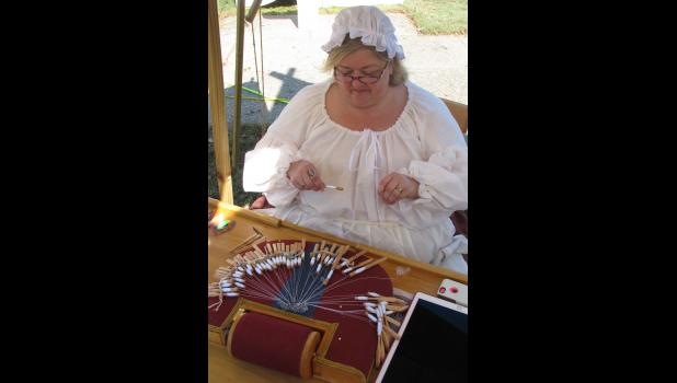 "Jane Sechrest of Harrisburg showed the very fine art of lace making to visitors who attended the encampment. She was using a somewhat modern day tool, ""ye olde iPadde."""