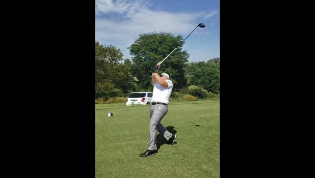 """Andrew """"Thor"""" Herbert gave a demonstration of his driving ability on the 18th hole of the course. As part of the day's events, Herbert would hit a 400-yard drive for each player to start the hole."""