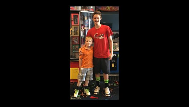 Logan Quick, left, won 1st place in the under 8 years boys division with a 3-game series of 334 and Aden Hopkins, right, received 6th place with a 3-game series of 807. Photo provided.