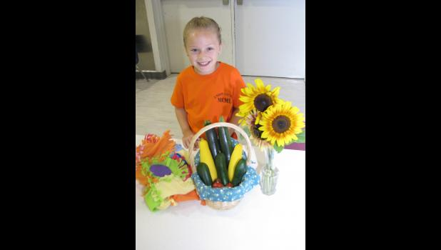 Mackenzie Barnhart of Jonesboro showed sunflowers, vegetables and a blanket she had made. Mackenzie is a member of the MCML 4-H Club and the daughter of Daryl and Amanda Barnhart.