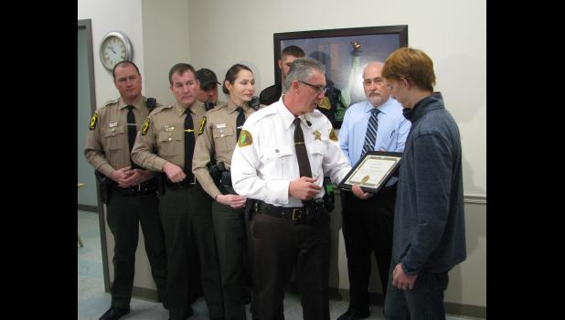 Union County Sheriff Scott Harvel, third from right, presented a Life Saving Award to Kyle McMahan, right. The award was presented during a ceremony held Jan. 17 at the Union County Sheriff's Office in Jonesboro. Other law enforcement and emergency services personnel were in attendance.