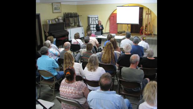 More than 30 people attended a medical cannabis educational seminar, which was presented last Saturday at Stinson Memorial Library in Anna. The seminar was presented by Caprice Sweatt (near the center at the top), the founder of Medical Cannabis Outreach.