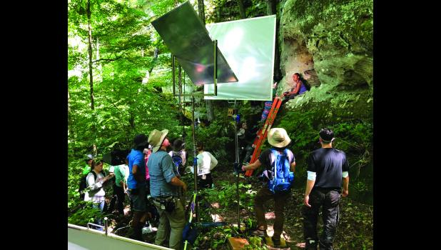 "The crew of ""Range Runners"" gathered at the base of one of the bluffs in Big Rocky Hollow at Ferne Clyffe State Park as actress Celeste M. Cooper prepared for her scene from her perch above them during filming in early June. Photo provided."