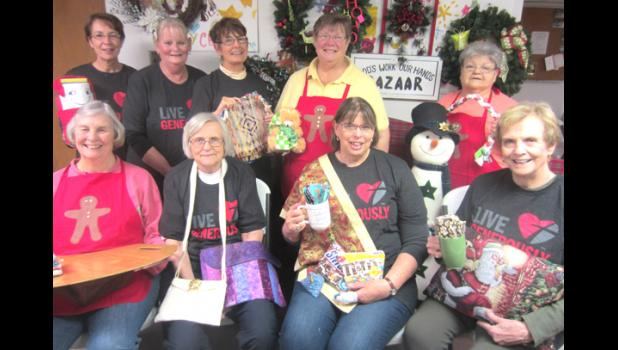 The annual Gingerbread House Bazaar is part of Christmas in Downtown Anna on Saturday, Nov. 26, from 9 a.m. to 2 p.m., at Mt. Moriah Lutheran Church. Displaying craft items that will be available are, in back, Sarah Hensch, Liz Kelley, Kay Rothschild, Deb Rossberg, and Ann West, and, in front, Judy Lyerla, Connie Ray, Patty Simpson and Kathleen Wright. File photo provided.