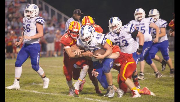 Anna-Jonesboro junior Jayce Turner, number 42, with the ball, looks for some running room. Other Wildcats in the photograph are senior Aaron Lence, number 56; senior Kris Potter, number 73; senior Shad Turner, number 75; sophomore Dylan Cunningham, number 72.