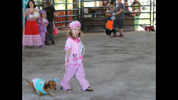 This year's pet parade was held on Sunday, Aug. 21, in the junior livestock show ring. Categories included smallest pet, prettiest pet, most unusual pet, best dressed pet in costume and best trained dog. Photo by Lindsey Rae Vaughn.