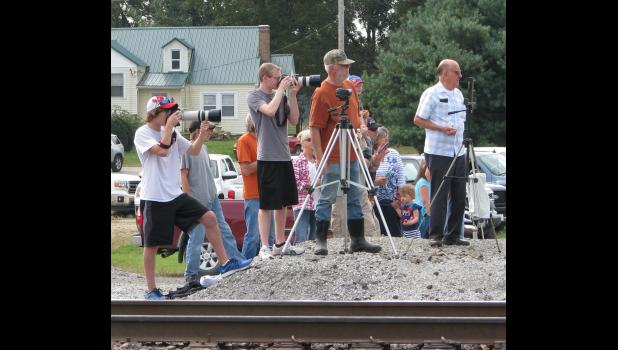 Photographers were lined up to take pictures as steam locomotive No. 844 arrived in Wolf Lake.