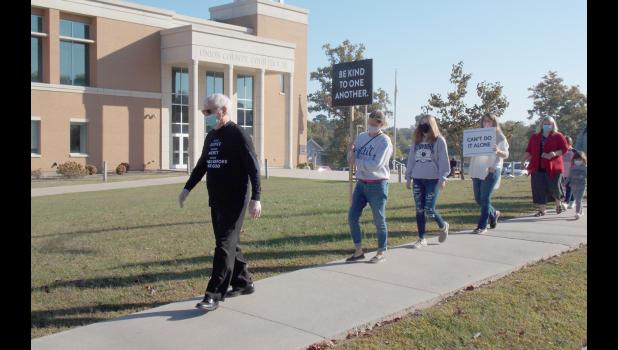 """During October, former Southern Illinois Congressman Glenn Poshard is leading """"silent marches"""" throughout the region in a call for a return to peace, unity and civility during a tumultuous time in the nation's history. On Wednesday, Oct. 7, Poshard, left, led a march at the Union County Courthouse in Jonesboro."""