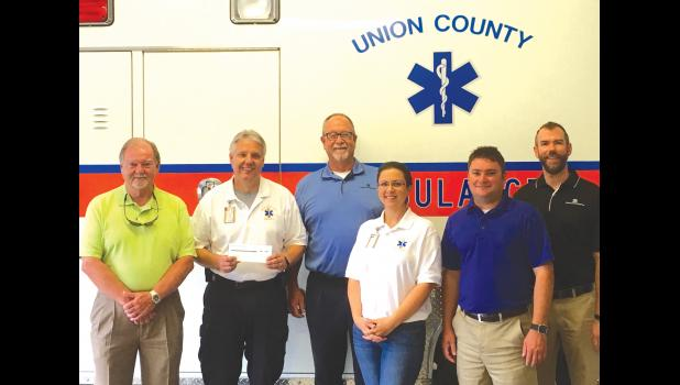 From left are Union County commissioner Max Miller, Union County Ambulance Service director Grant Capel, Ray Diel of Snedeker Risk Management (which represents ICRMT), Union County Ambulance Service assistant director Jaime Watkins, Kyle Shell from ICRMT and Kevin Kern from the Snedeker Risk Management Group. Photo provided.