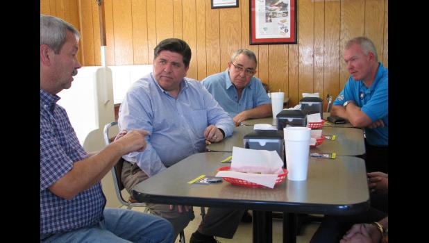 Democratic Party gubernatorial candidate JB Pritzker, second from left, brought his campaign to Union County last week for an informal gathering in Jonesboro. Among those present were, from left, Anna Mayor Steve Hartline, Pritzker, Democrat Todd Vincent of Anna and State Rep. Brandon Phelps, D-Harrisburg.
