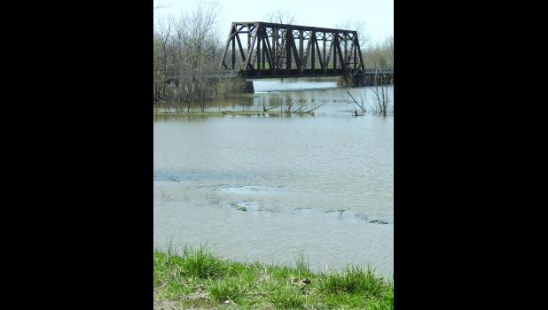 High water was seen under a railroad bridge over the Big Muddy River during a visit on Sunday afternoon, March 21. At the time, a flood warning was in effect for the river.