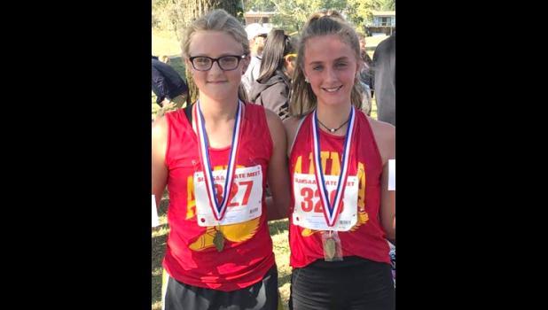 Anna Junior High School medalists Raelynn Sadler, left, and Kayla Matuszewich. Photo provided.