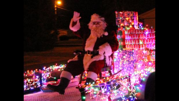 Santa Claus participated in the Light Up Tamms parade after he visited with children. Photo by Lindsey Rae Vaughn.
