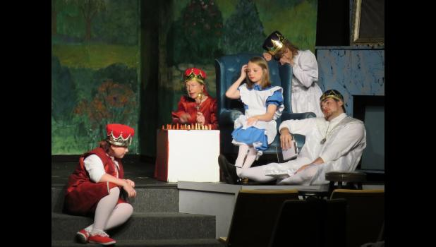 Alice brings the chess pieces to life. From left are Zach Finstad as the Red King, Nancy Kucera as the Red Queen, Brinley Corbit as Alice Through the Looking Glass, Debby McKibben as the White Queen and Kevin Thomas as the White King.
