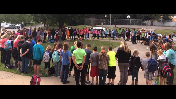 Students prayed in a circle around the Anna Junior High/Davie School flag pole to pray before school on Wednesday morning, Sept. 28. Photo provided.