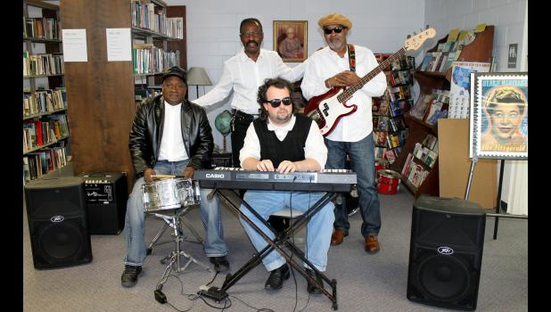 The blues tribute band Small Chance performed at the Mounds Public Library on Saturday, Feb. 25. Band members are George Moss, drums; Gerald Long, keyboard; Larry Baldwin, vocals; and Owen Terry, guitar. Photo by Lindsey Rae Vaughn.