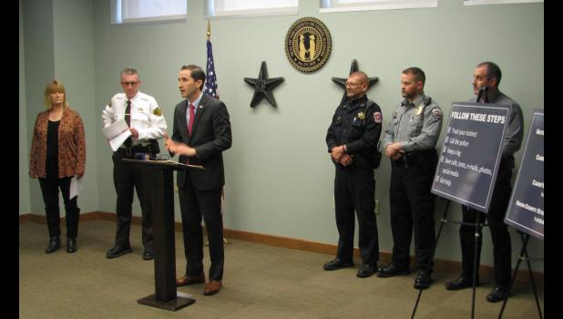 Union County State's Attorney Tyler R. Edmonds, standing at the podium, addressed those at a press conference which was held Wednesday morning, Jan. 10. The event was held at the Union County Courthouse in Jonesboro. Also in the picture are Cathy McClanahan, the executive director of The Women's Center; Union County Sheriff Scott Harvel, Anna Police Chief Mike Hunter, Cobden Police Chief B.J. Hale and Anna Police Assistant Chief Bryan Watkins.