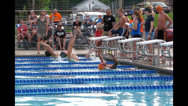 The picture was taken at the start of a back stroke event.