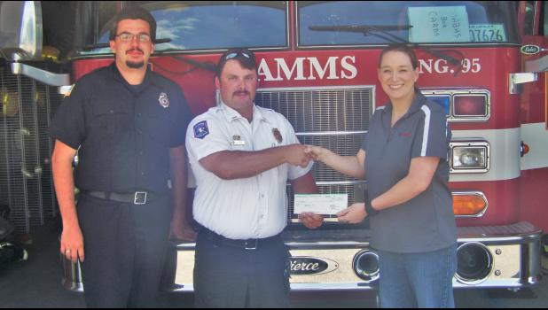 The Tamms Volunteer Fire Department recently received a $500 donation from Unimin Specialty Minerals Inc. From left are Lt. Jeffrey Dinsmore, Fire Chief Jesse Kerr and Unimin health and safety coordinator Dasha Fehrenbacher. Photo provided.