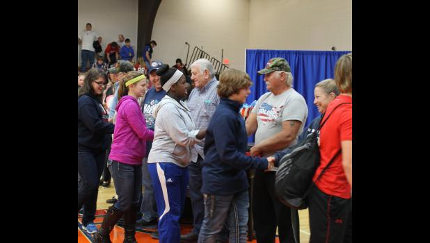 Students thanked veterans, who were lined up, by shaking their hands at the program.
