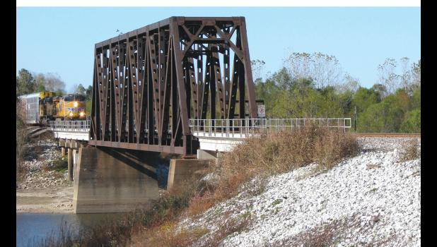 A freight train was about to make its way onto a bridge over the Big Muddy River north of metropolitan Wolf Lake last Friday afternoon.