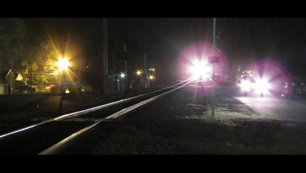 Night lights...an oncoming, northbound freight train, headlights on vehicles and streetlights helped to create this image.