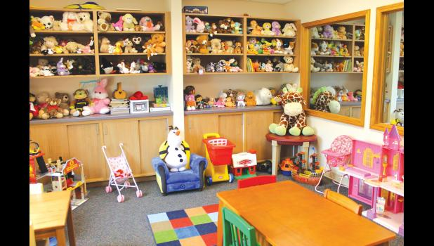 One of the waiting rooms at the Two Rivers Child Advocacy Center is full of stuffed animals and toys for children to play with.
