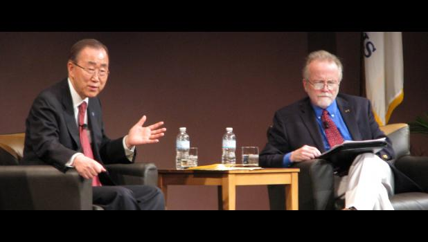 United Nations Secretary-General Ban Ki-moon, left, addresses the audience on Dec. 21 at Southern Illinois University Carbondale. To the right is Jak Tichenor, the interim director of the Paul Simon Public Policy Institute in Carbondale.