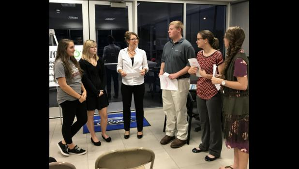 From left are Grace Schroeder and Zoe Fuhrhop, representing Team 2018; Kathy Bryan, facilitator; and Team 2017 representatives, Shad Turner, Jessica Glasco and Jessa Bond. Photo provided.