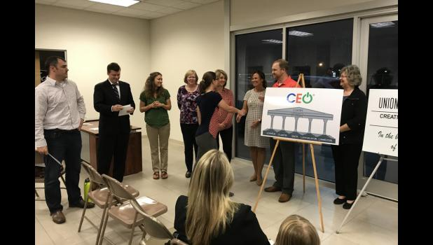Union County CEO board members who were on hand for a recent event at Coad's Ford building in Anna included Mark Chamness, Darren Bailey, Natalie McLean-Miller, Beth Marks, Mindy Carter, Crystal Housman, Ryan Carter and Evelyn Bailey,  with CEO team member Jessica Glasco. Photo provided.